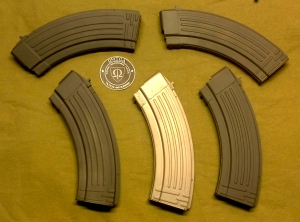 As you can see the difference between the center gray magazine and the fleshly painted ones surrounding it.
